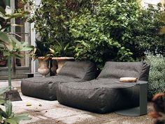 modern gray outdoor chairs on concrete patio / sfgirlbybay
