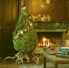 AMAZING Christmas Tree picture I stumbled onto via pinterest. Moss, roots, and pine~simple, rustic, and elegant all at the same time. This would be fun to make.
