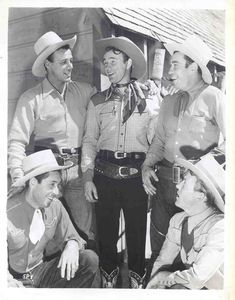 Roy Rogers & the Sons of the Pioneers are re-united at Republic Pictures - 1941.  From l. to r. - Karl Farr (kneeling) - Bob Nolan - Roy Rogers - Hugh Farr - Tim Spencer (kneeling).