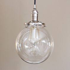 8 round clear glass globe pendant fixture by OldeBrickLighting | I like that it is on the smaller side.