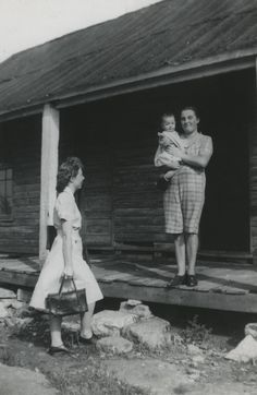 Josephine Rogers, senior nursing student from Vanderbilt School of Nursing, visits a mother and baby in a rural home in Rutherford County, Tennessee. This is part of her two months' field experience in public health nursing. (1946)