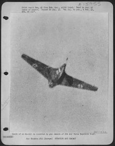 An Me 163 Komet is shot down by a Republic P-47 of the 8th Air Force.
