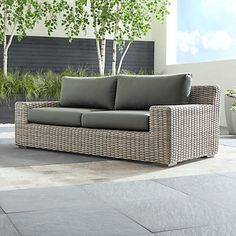 Cayman Outdoor Ottoman with Grey Cushion + Reviews | Crate and Barrel Outdoor Couch, Wicker Patio Furniture, Outdoor Sofa Cushions, Furniture, Outdoor Sofa, Sunbrella Cushions, Lounge Furniture, Wicker Sofa, Wicker Furniture