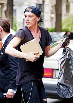 Jamie Campbell Bower arriving at their hotel on the Upper East Side in New York City - May 3, 2014