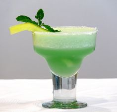 Honeydew Rita-Margarita: Lime Wedges, Sugar, Ice, Honeydew Melon, Tequila, Honey, Lime Juice, Green food coloring (optional), Sprigs Mint.