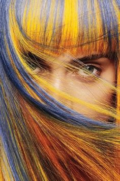 Blue and yellow hair with blunt fringeby Aveda.
