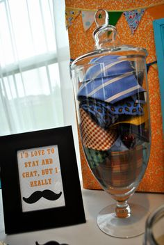 Mustache Bash Baby Shower --- Love this idea. Just got to find a vase like this....and sneak some of Mark's ties out of the closet...
