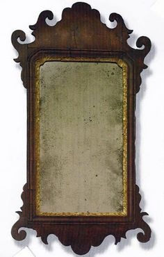 A Fine Chippendale Mahogany Mirror, American, Possibly Philadelphia, Circa 1770, veneered mahogany frame with shaped outline and scrolled ears, pine secondary wood, length 22.5 in., width 12.5 in.