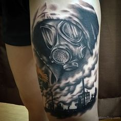 Left Thigh Grey Ink Gas Mask Tattoo