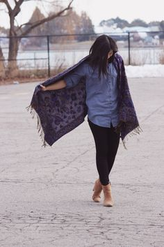 Shop this look on Lookastic:  http://lookastic.com/women/looks/blue-dress-shirt-purple-shawl-black-skinny-jeans-tan-ankle-boots/8869  — Blue Chambray Dress Shirt  — Purple Print Shawl  — Black Skinny Jeans  — Tan Suede Ankle Boots