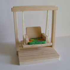 Wooden Doll Swing Set, Doll House Accessories, Natural Wood Waldorf- inspired Toy, fits Barbie Christmas gift. $19.95, via Etsy.