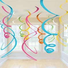 """Add some bright neon colors to your party decorations and hang our 22"""" multi color swirls from ceilings over tables, in windows or doorways.  The perfect for tropical theme decorations, holiday decorations and birthday decorations. Each pack of assorted swirls has 12 colorful swirls to the pack. $3.05"""
