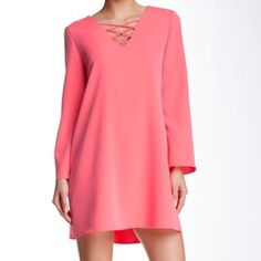 """ECI Lattice Bell Sleeve Mini Dress A solid bell sleeve mini dress with criss crossing lattice front. V-Neck with lattice detail. Long bell sleeves. Boxy silhouette . Lined. Approx 33"""" length. Shell 97% polyester/3% spandex (some stretch to fabric) color : hot pink. Size: Medium . Armpit to armpit flat across 20"""". Brand new with tags from Nordstrom ECI Dresses Mini"""