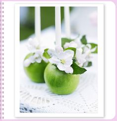 Apple candleholders adorned with blossom. Photographer: Ragnar Omarsson