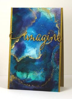 After watching a video from Sandy Allnock   https://www.youtube.com/watch?v=IOMVB3Dewnk  I created a watercolour background and added gold accents and a stacked die cut sentiment.  http://cards.heathertelford.com/2015/03/15/imagine/