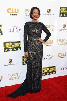 Aisha Tyler brought dark romantic glamour to the red carpet with an ornate long-sleeved beaded Tadashi Shoji gown.