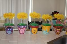 centerpieces made with terra cota pots acrylic paint sponged paint on the background painted pooh characters by hand used square foam and cut to fit inside the pots added Easter grass and stuck the fake flowers into the foam. Boy Birthday Parties, Baby Shower Parties, Baby Shower Themes, Baby Boy Shower, 2nd Birthday, Baby Showers, Shower Ideas, Winnie The Pooh Themes, Winnie The Pooh Birthday