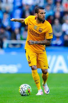 Dani Alves of FC Barcelona runs with the ball during the La Liga match between RC Deportivo La Coruna and FC Barcelona at Riazor Stadium on April 20, 2016 in La Coruna