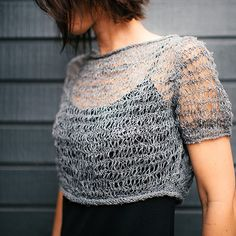 A wonderfully light, open fabric makes this cropped sweater perfect for popping over a tee, dress, or blouse. Generously sized,...