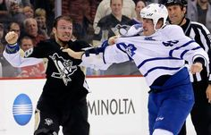 Pittsburgh Penguins' Zach Sill, left, fights with Toronto Maple Leafs' Troy Bodie