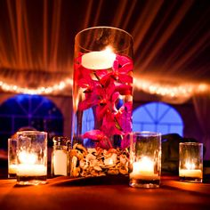 Love the ambiance created by this simple centerpiece with submerged flowers and candles!