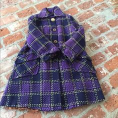 Vintage plaid purple coat MAKE AN OFFER! One of a kind coat!  Beautiful in the outside with big buttons and pockets!  Shows some wear in the inside. Will post more pics if asked. No tag so unsure if the exact size, fits a small. Vintage Jackets & Coats