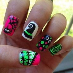 Go neon with this bright and bubbly looking Halloween nail art design. Use black and other neon colors as your base coat and paint n random shapes and lines on top using contrasting colors. These look even better at night.