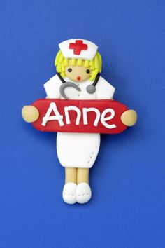"""Nurse """"Anne"""" holding red tablet name plate. Polymer Clay Brooch by Jo Joz Art Studio"""