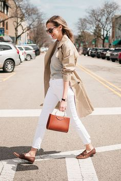 Beige trench coat, light grey sweater, white jeans, brown loafers, brown ring handle bag. #trenchcoat #ss18 #springstyle #streetstyle #stylish #fashion2018 #fashiontrends2018 #ootd #outfitideas #outfitinspiration #weartowork #casualstyle #comfystyle #loafers spring casual outfit, trench coat outfit