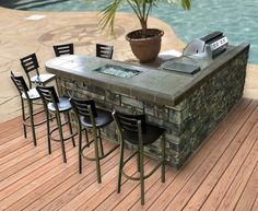L-Shaped island with rectangle fire pit. Stone front with tile counter and bar ledge.