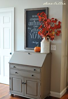 Old chests like this can easily be found at yard and church sales and be transformed with the right paint. Here it's a warm neutral. The color contrasts happen with accessories.