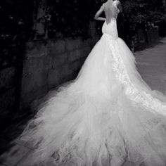 Beautiful fairy tale wedding dress with low cut back and long train. Wow! I am not in the market for a wedding dress, but this is just too beautiful not to repin!