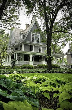 Steeply pitched rooflines and and an inviting wraparound porch. Yum.