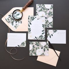 Vintage botanical etchings of white florals and lush greenery with light taupe gray accents and blush envelopes make the perfect pair for