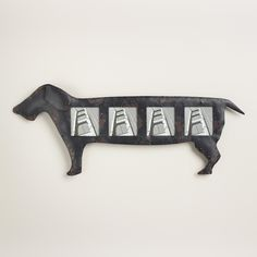 An adorable addition to any dog lover's home, our distressed metal dachshund-shaped frame offers up space for four photos of your favorite pooch. >> #WorldMarket Pet Lovers