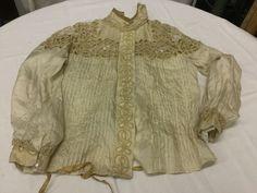 Found on EstateSales.NET: cutwork silk shirtwaist has some rot on arm