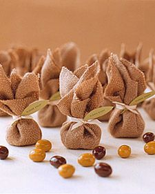 """Echo the rustic olive theme of your wedding-day appetizers with chocolate """"olives"""" bundled as favors for guests to take home."""