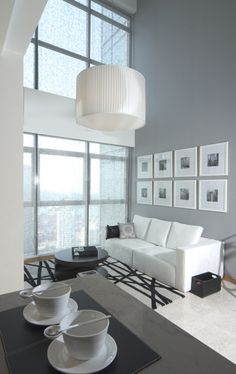 Love the grey, black, and white color scheme, the large windows, the rug, and the contemporary feeling of this room.
