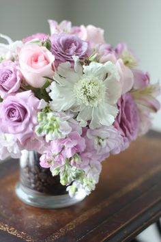 the bees loved this arrangement of stock, scabiosa, spray roses, sweet akito roses and alstromeria (coffee bean filled vase)