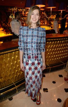 Rosamund Pike in a Marc Jacobs dress and sneakers