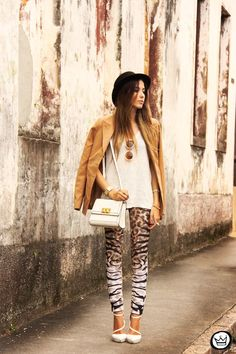 Shop this look for $180:  http://lookastic.com/women/looks/blazer-and-sleeveless-top-and-satchel-bag-and-leggings-and-heels-and-hat/1405  — Tan Blazer  — White Knit Sleeveless Top  — White Leather Satchel Bag  — Brown Leopard Leggings  — White Leather Pumps  — Black Hat