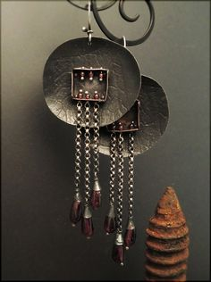 Earrings | Victoria Takahashi. Sterling silver, garnet, copper. I like some aspects of these.