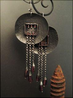 Earrings | Victoria Takahashi.  Sterling silver, garnet, copper.