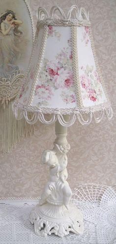 Soft white cherub with handcrafted rose shade