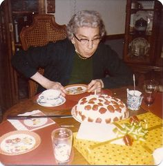 Old Auntie Gladys blowing out the candles on her birthday cake. She was 71...I've just turned 74!  Oh my, how time flies.  Cookie...