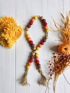 This fall leaf colored farmhouse garland is approx 34 inches long.It's made of hand painted beads on a jute rope with handmade jute tassels.Add these to your coffee bar, tier trays or shelves for added decor. Leaf Crafts, Fall Crafts, Diy And Crafts, Halloween Crafts, Rustic Halloween, Haunted Halloween, Holiday Crafts, Fall Garland, Diy Garland