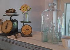 Vintage scales and bottles under cloche