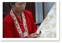 A woman making batik.