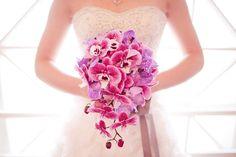 Exotic-cascading-wedding-bouquet-of-purple-pink-orchids.original
