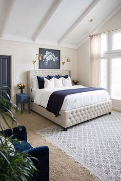 Love this master bedroom makeover - and that tufted bed! #bedroom #bedroommakeover #roommakeover #neutraldecor #masterbedroom